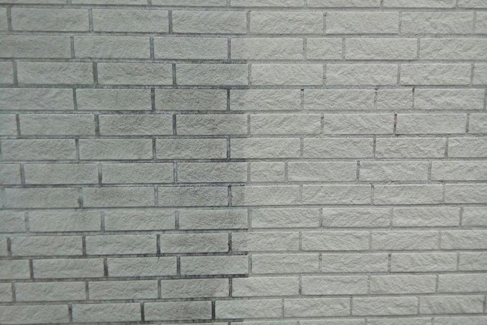 Reinigung einer Kalksandsteinfassade